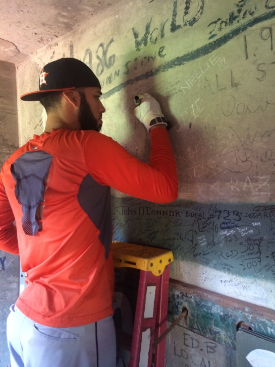 Marwin Gonzalez takes his time signing the wall.