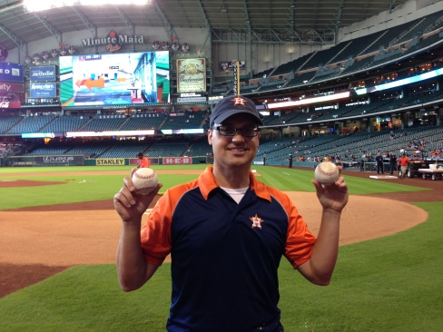 Lucky fan Tim Pinkard poses with his autographed Chris Carter home run balls