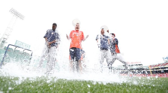 Fowler, Luhnow and Altuve accept the Ice Bucket Challenge at Fenway Park. (Photo credit: Mark L. Baer-USA TODAY Sports