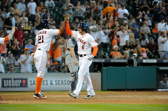 Marisnick and Fowler high five