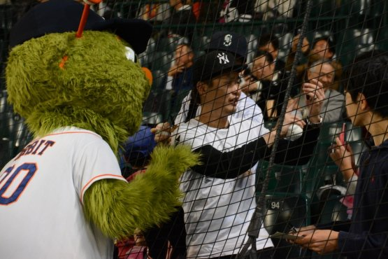 Orbit takes a selfie with a Japanese fan