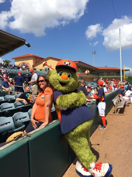 Orbit posed for an Astros fan before the game