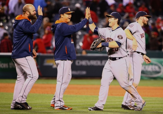 Preston Tucker high fives with teammate Hank Conger after the Astros big win. (Photo by Victor Decolongon/ Getty Images)