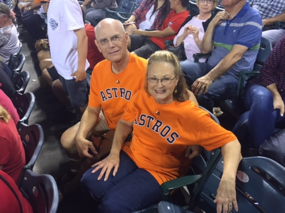 The Bergs are all smiles as they watch Correa on the field